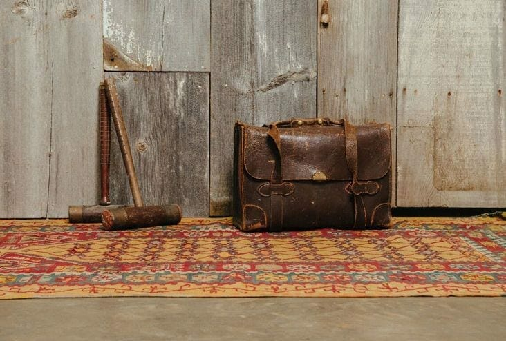 leather satchel and vintage mallets