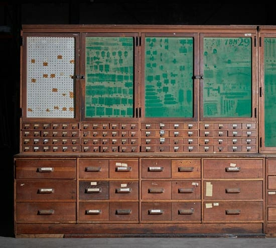 vintage hardware cabinet with felt doors